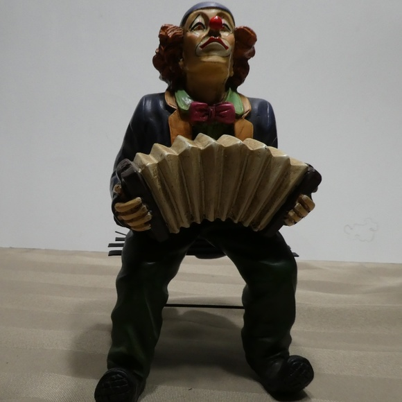 CLOWN porcelain sitting on bench playing accordion